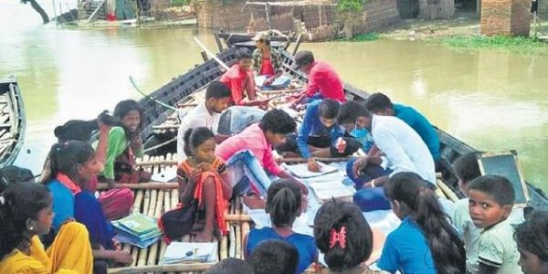 Young Teachers take Classes on Boats after Floods Submerge Bihar Schools